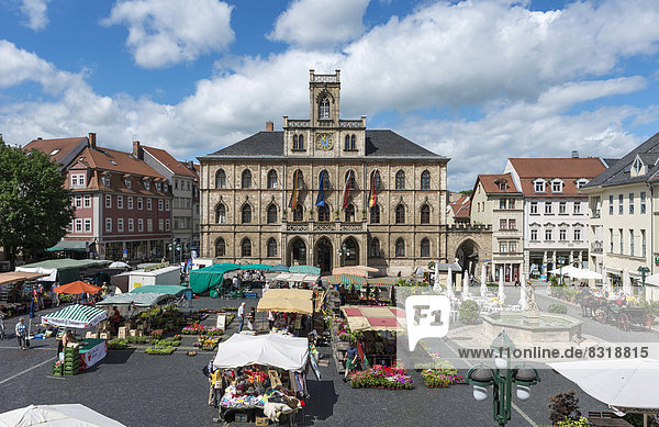 Market square with weekly market  Town Hall at back