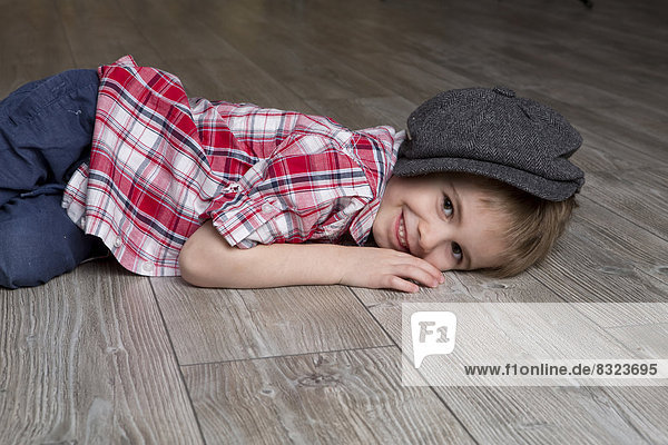 Smiling boy lying on floor