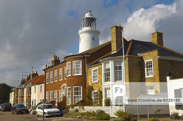 Lighthouse and sea front houses