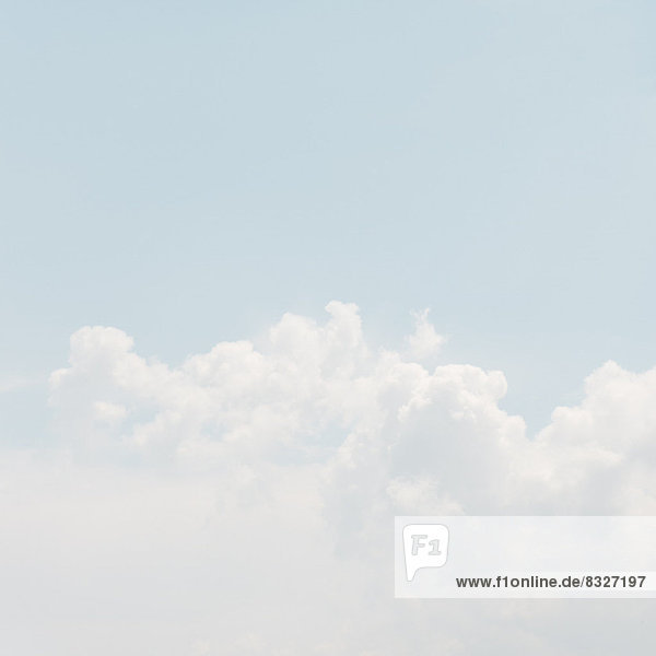 Sky with puffy clouds