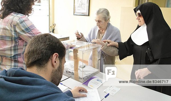 Date :22-05-2011 Municipal elections in Galicia  polls. The people exercise their right to vote. In the picture  street polling Lugo Rio Neira. In this table are allegations  by some political parties  to ensure  that the nuns of San Roque asylum accompany the elderly with a closed ballot and invite them to vote with the nuns sealed envelope delivered them.