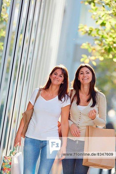 Women sisters 35 and 40 years shopping on the street. Donostia. San Sebastian. Gipuzkoa. Basque Country- Spain.