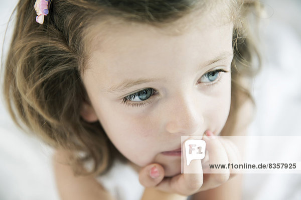 Portrait of thoughtful little girl  close-up