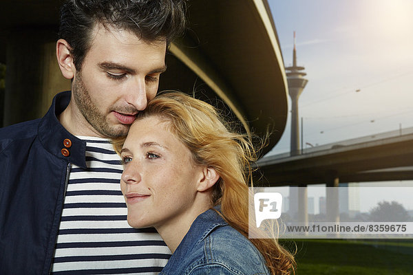 Germany  Dusseldorf  Young couple embracing