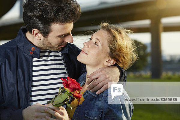 Germany  Dusseldorf  Young couple with red rose