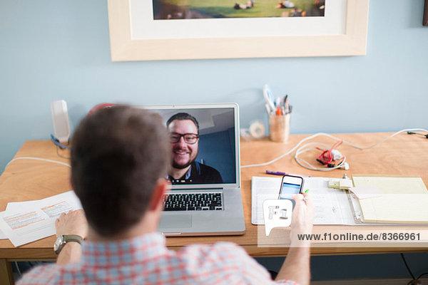 Man sitting at desk making video call