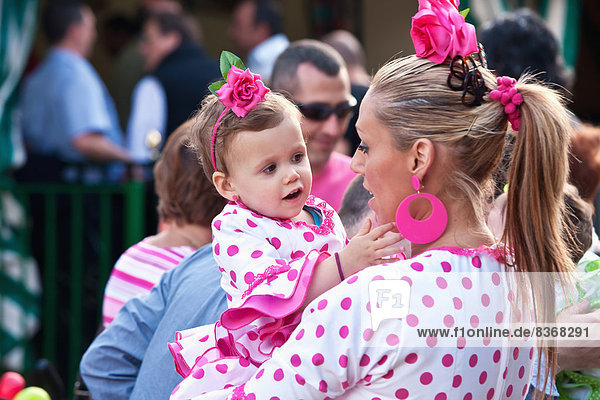 Woman With Daughter In Traditional Seville Clothing At April Fearia Festival Seville  Andalucia  Spain  Europe