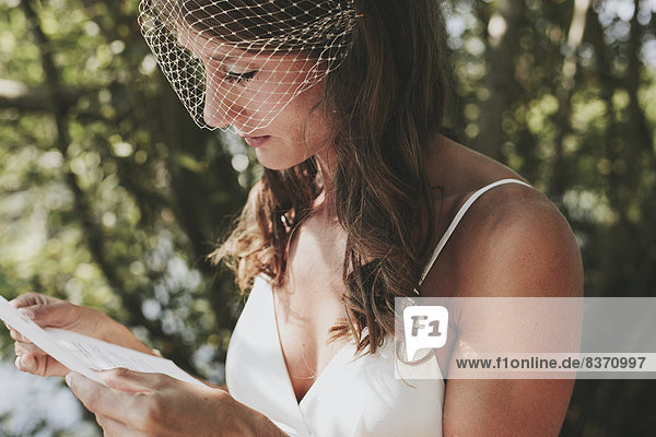 A Bride Reading From A Piece Of Paper Kirkland  Washington  United States Of America