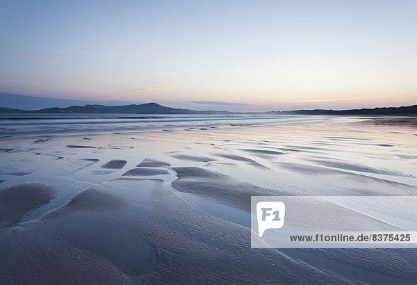 über Sonnenaufgang Bucht Donegal Irland
