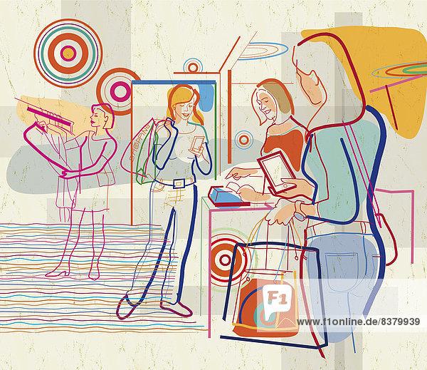 Frauen in Kleidergeschäft nutzen mobile Geräte Frauen in Kleidergeschäft nutzen mobile Geräte