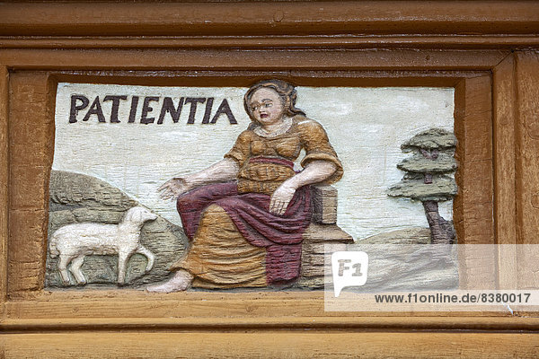 Patientia  Latin for patience  wood carving  Alte Lateinschule Alfeld building  Alfeld  Lower Saxony  Germany