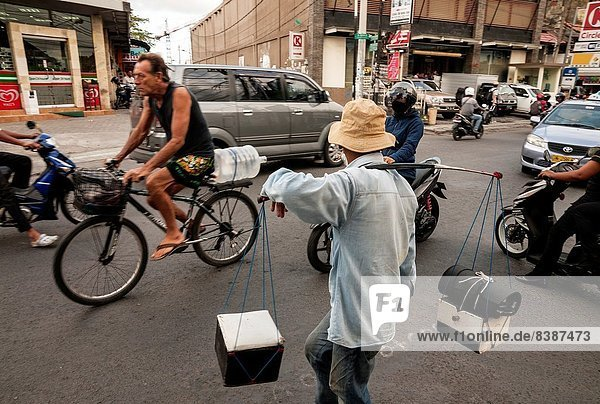 Shoe shine and mobile street cobbler on the Legian road  Legian  Bali  Indonesia.