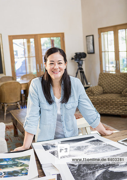 Mixed race photographer examining photographs