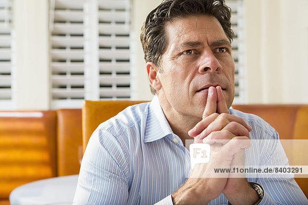 Caucasian businessman sitting in restaurant