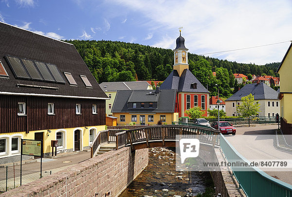 Germany  Saxony  Schmiedeberg  Townscape with River Poebelbach and Trinity Church
