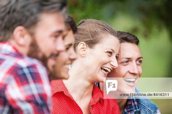 Close up shot of four friends smiling  Tyrol Austria