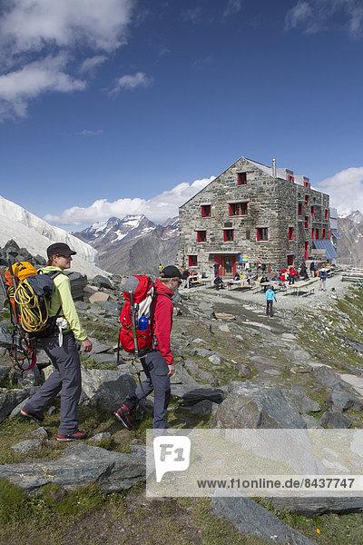Bergsteigen Hütte Frau Berg Mann gehen Klettern Graubruststrandläufer Calidris melanotos Berghütte