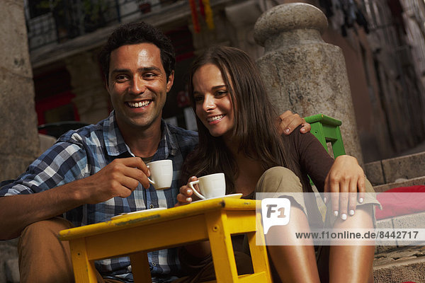 Portugal  Lisboa  Bairro Alto  young couple sitting at street cafe at dusk