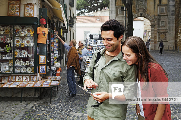 Portugal  Lisboa  Baixa  Rossio  young couple looking at postcard