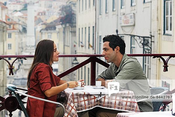Portugal  Lisboa  Carmo  Largo du Duque  young couple sitting at street cafe