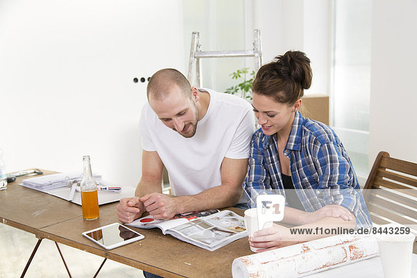 Young couple moving into new home  taking a break