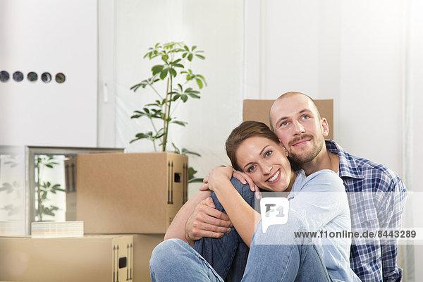 Young couple enjoying new home