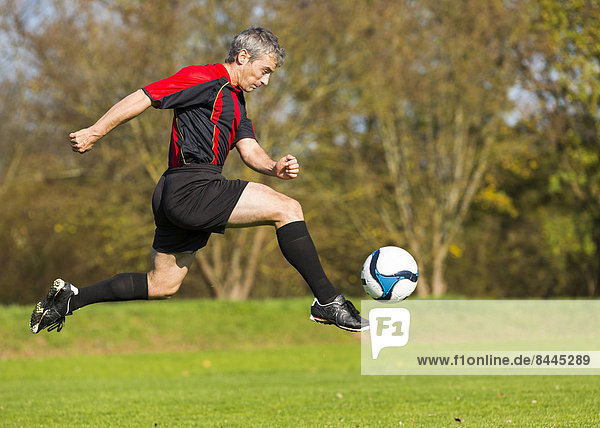 Soccer player with ball on field