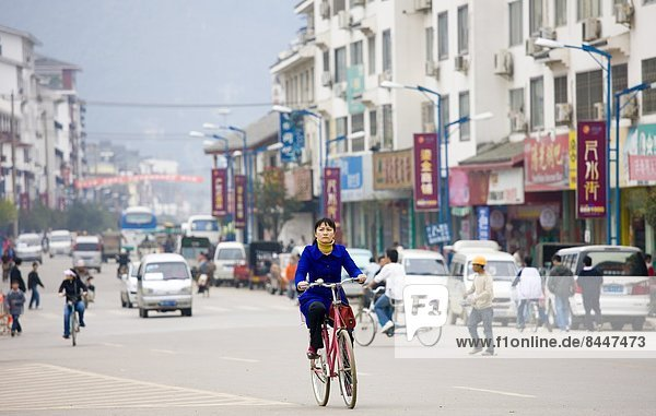 Woman on a bicycle in Yangshuo street  China