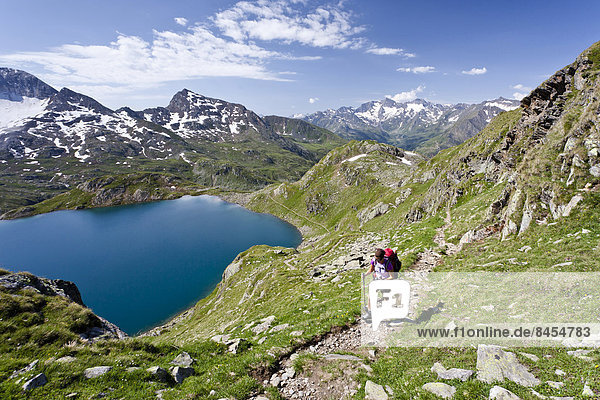Climbers above Großer Schwarzsee Lake  during the ascent of Mt Zuckerhütl from Passeiertal Valley  South Tyrol  Trentino-Alto Adige  Italy
