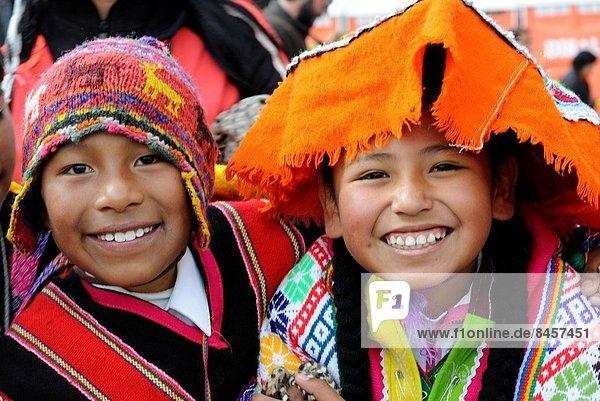 Peruvian boy and girl wearing in traditional costume  Peru South America.