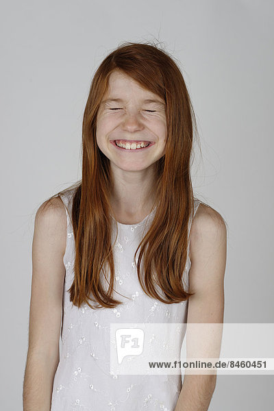 Girl laughing with her eyes closed