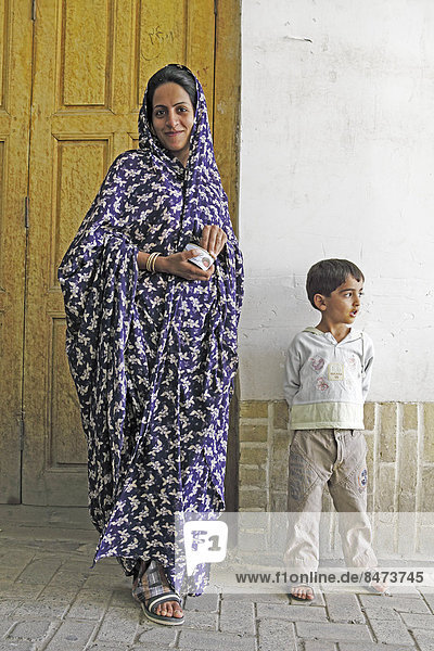 Woman in modern chador with son  old town  Yazd  Yazd Province  Persia  Iran
