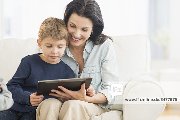 Mother and son (6-7) with tablet pc