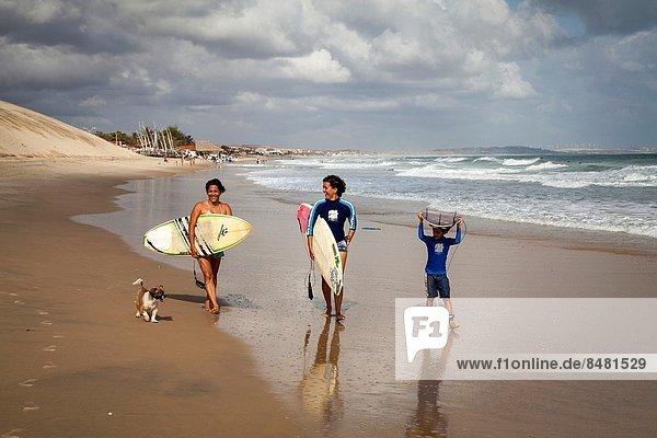 Surfers on the beach in Iguape  Fortaleza district  Brazil.