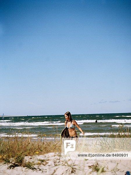Teenage girl on beach  Gotland  Sweden