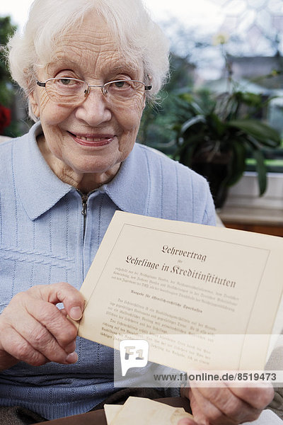 Senior women showing her old training contract