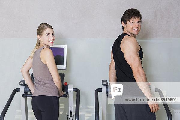 Austria  Klagenfurt  Couple training on treadmill