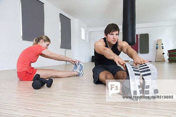 Austria  Klagenfurt  Couple doing warm up training