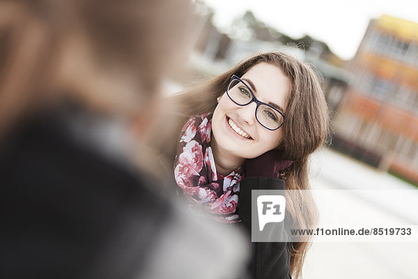 Smiling young woman outdoors