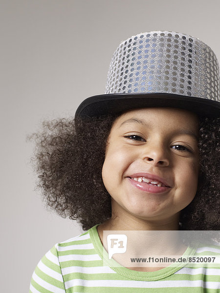 Smiling girl wearing top hat