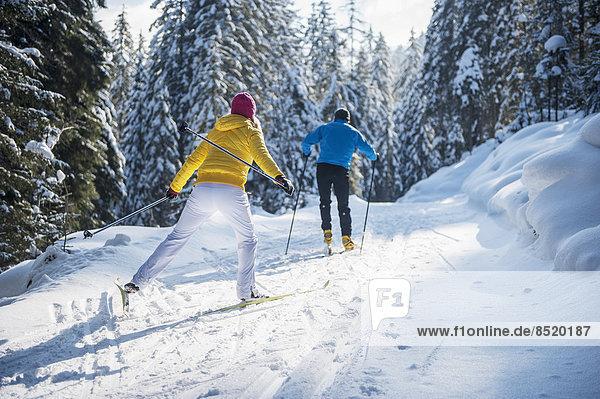 Austria  Salzburg Country  Altenmarkt-Zauchensee  Young couple cross-country skiing