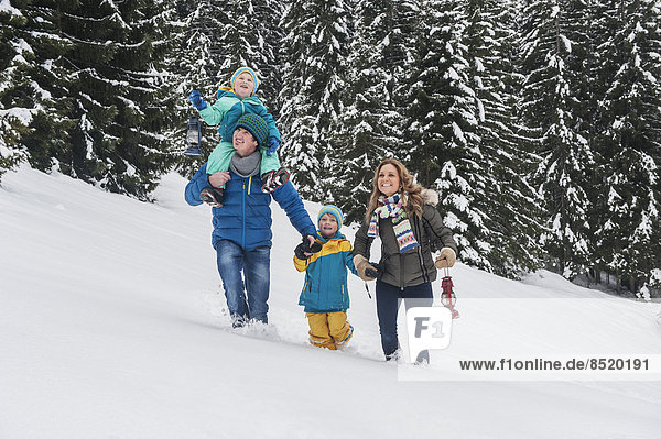 Austria  Salzburg Country  Altenmarkt-Zauchensee  Family walking in snow