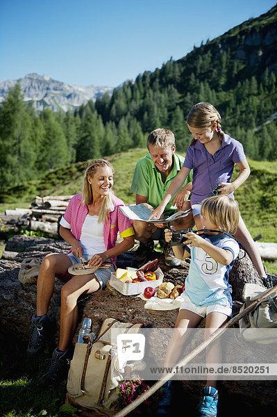 Austria  Salzburg State  Altenmarkt-Zauchensee  family with to children haßing a picnic