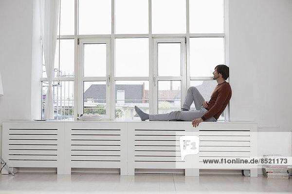 Man sitting at window Man sitting at window