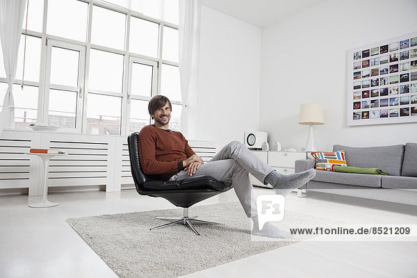 Man at home  sitting in chair