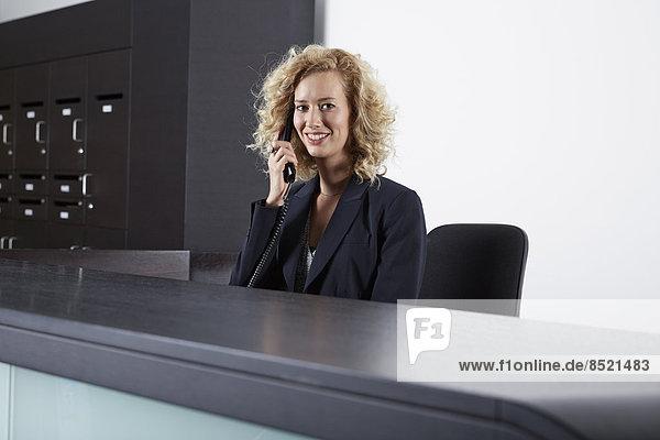 Germany  Neuss  Receptionist on the phone