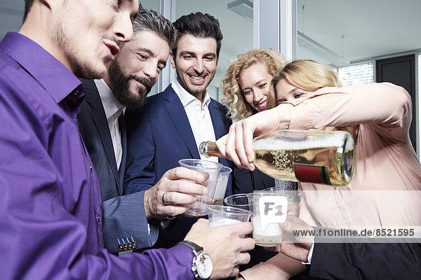 Germany  Neuss  Business people celebrating in office