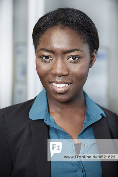 Portrait of young Afro-european business woman
