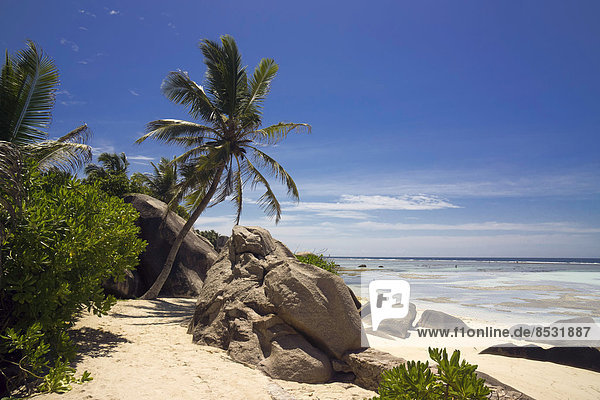 Typical rock formations in the Seychelles with a sandy beach  Anse Union  La Digue  Seychelles