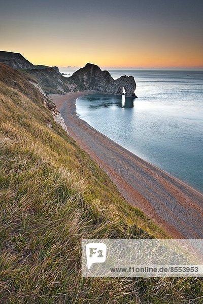 Just before sunrise at Durdle Door on the Jurassic Coastline in Dorset.